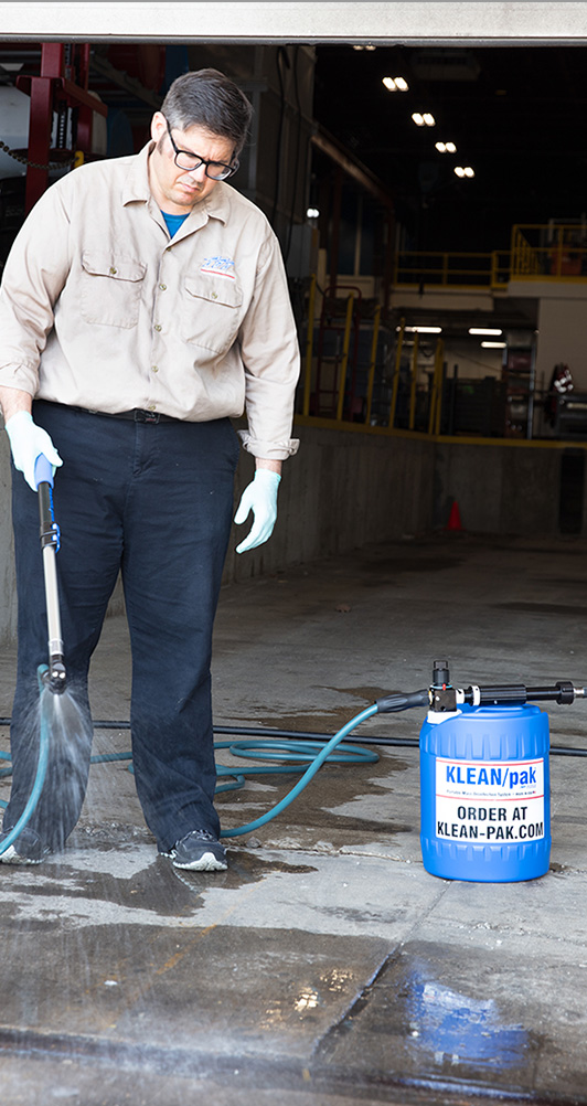 Guy disinfecting a truck loading dock